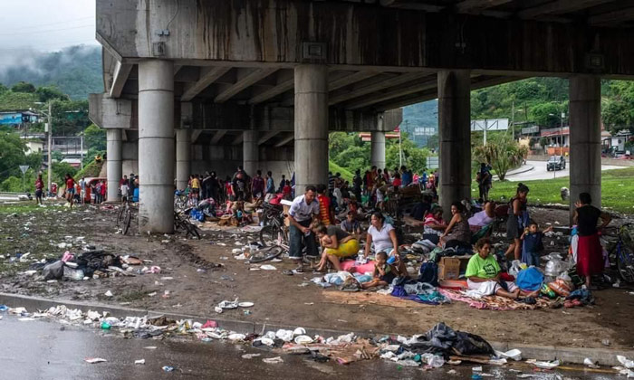 People displaced by the storms are living under a bridge in Honduras
